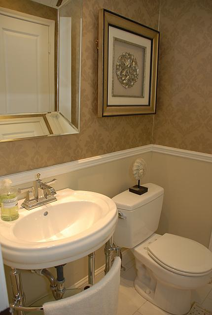 Powder room after classic wallpaper above the chair for Small bathroom ideas 20 of the best